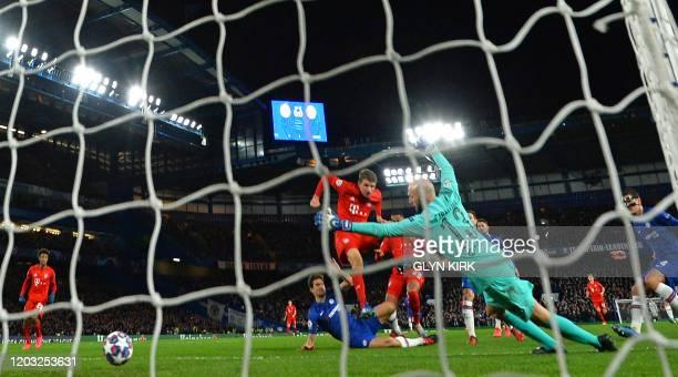 Bayern Munich's German striker Serge Gnabry scores their first goal during the UEFA Champion's League round of 16 first leg football match between...