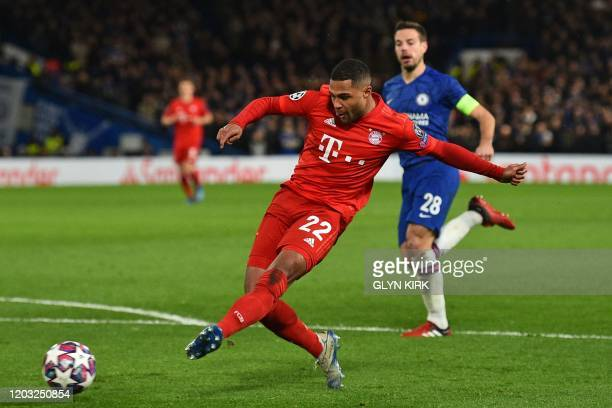 Bayern Munich's German striker Serge Gnabry shoots to score their second goal during the UEFA Champion's League round of 16 first leg football match...