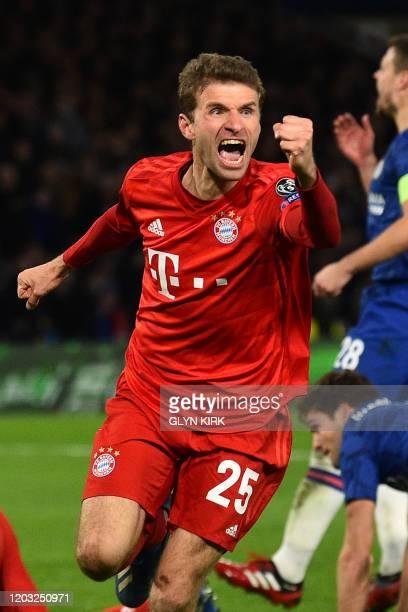 Bayern Munich's German striker Thomas Mueller celebrates after Bayern Munich's German striker Serge Gnabry scores the opening goal during the UEFA...