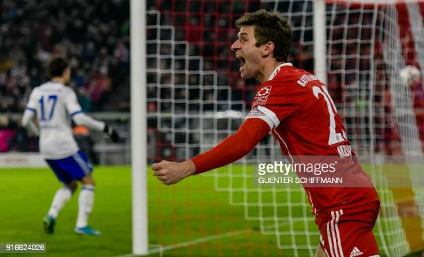 Bayern Munich's German striker Thomas Mueller celebrates scoring the second goal during the German first division Bundesliga football match FC Bayern...