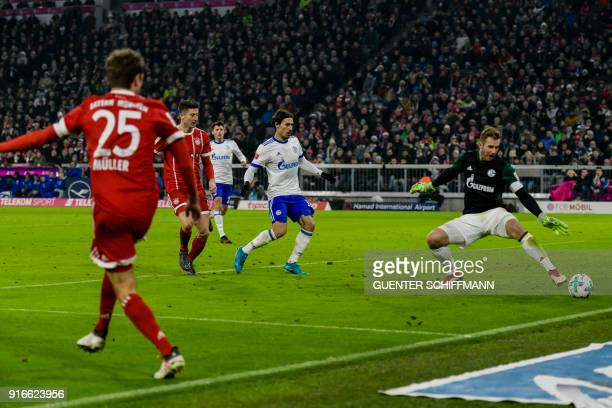 Bayern Munich's German striker Thomas Mueller scores the second goal during the German first division Bundesliga football match FC Bayern Munich vs...