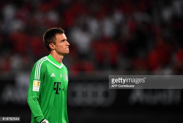 Bayern Munich's goalkeeper Christian Fruechtl reacts during the penalty shoot out during the International Champions Cup football match between...