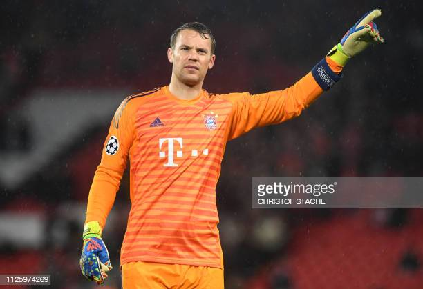 Bayern Munich's goalkeeper Manuel Neuer gestures after the UEFA Champions League round of 16 first leg football match between Liverpool and Bayern...