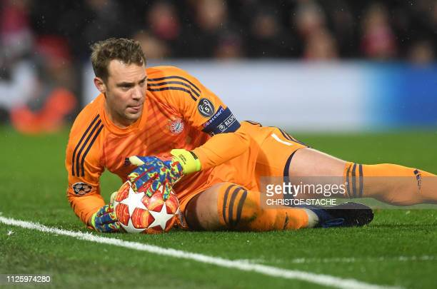 Bayern Munich's goalkeeper Manuel Neuer holds the ball during the UEFA Champions League round of 16 first leg football match between Liverpool and...