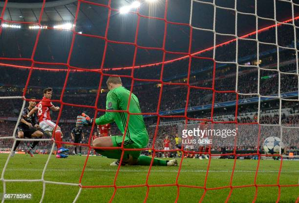 Bayern Munich's goalkeeper Manuel Neuer misses a goal from Real Madrid's Portuguese forward Cristiano Ronaldo during the UEFA Champions League 1st...