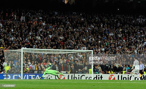 Bayern Munich's goalkeeper Manuel Neuer stops a penalty kick from Real Madrid's Portuguese forward Cristiano Ronaldo during the UEFA Champions League...