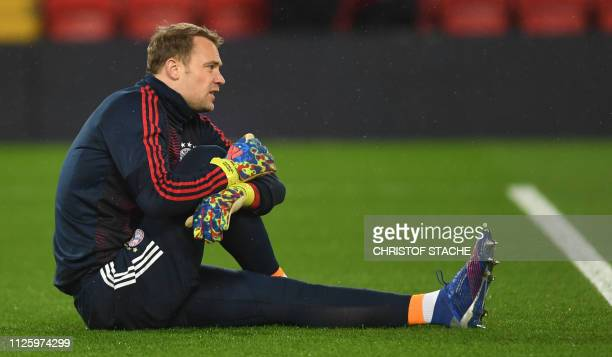 Bayern Munich's goalkeeper Manuel Neuer warms up prior the UEFA Champions League round of 16 first leg football match between Liverpool and Bayern...