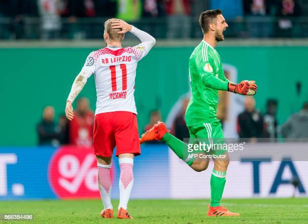 Bayern Munich´s goalkeeper Sven Ulreich celebrates after saving the deciding penalty by Leipzig's German forward Timo Werner to win the penalty shoot...