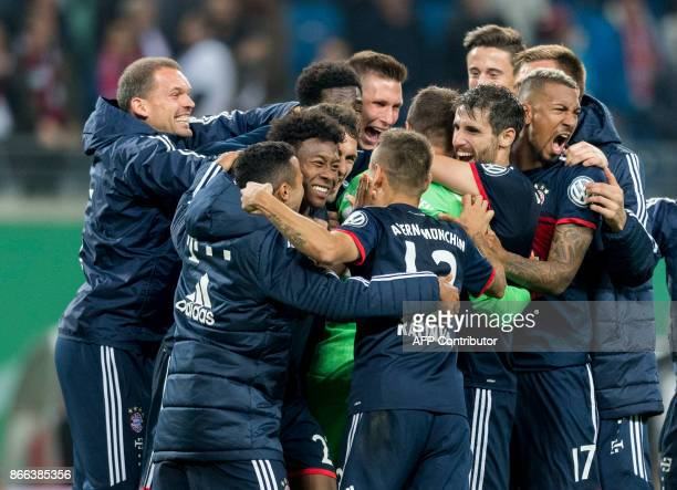 Bayern Munich´s goalkeeper Sven Ulreich celebrates with his teammate after winning the penalty shoot out and the match after the German Cup football...