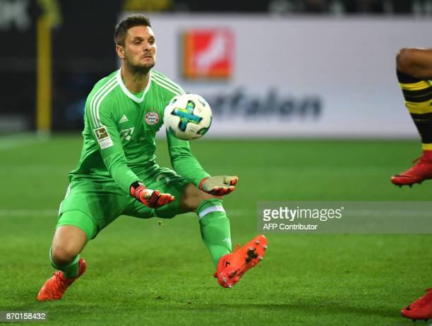 Bayern Munich´s goalkeeper Sven Ulreich tries to catch the ball during the German First division Bundesliga football match Borussia Dortmund vs...