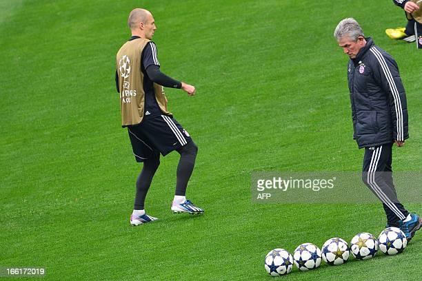 Bayern Munich's head coach Jupp Heynckes and Bayern Munich's Dutch midfielder Arjen Robben take part in a training session on the eve of the UEFA...