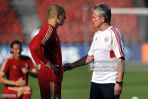 Bayern Munich's head coach Jupp Heynckes speaks to Dutch midfielder Arjen Robben during a training session in Zurich on August 22 on the eve of the...