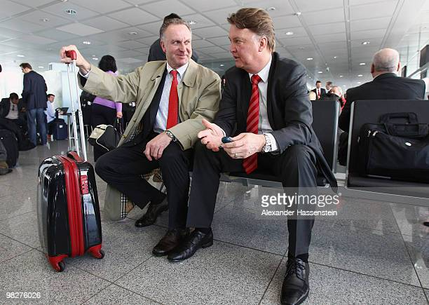 Bayern Munich's head coach Louis van Gaal talks to Bayern Munich's CEO KarlHeinz Rummenigge prior to their departure at the Munich Airport on April 6...