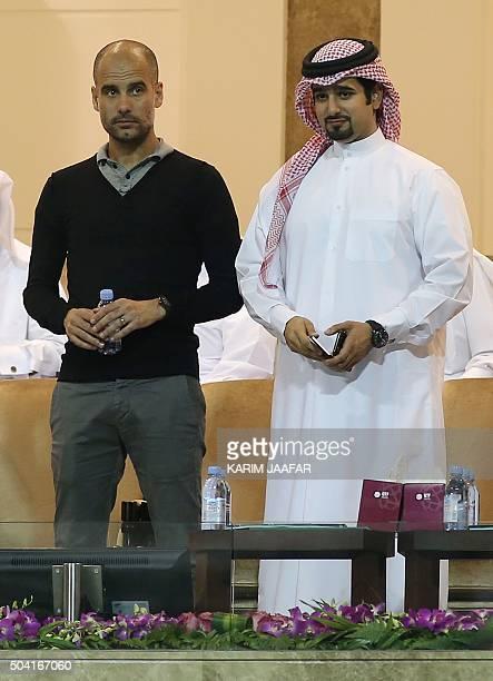 Bayern Munich's head coach Pep Guardiola and Qatar football Federation GeneralSecrtary Masour AlAnsari watch the final of the Qatar Open tennis...