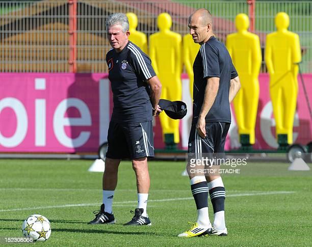 Bayern Munich's headcoach Jupp Heynckes and Bayern Munich's Dutch midfielder Arjen Robben take part in a training session on the eve of UEFA...