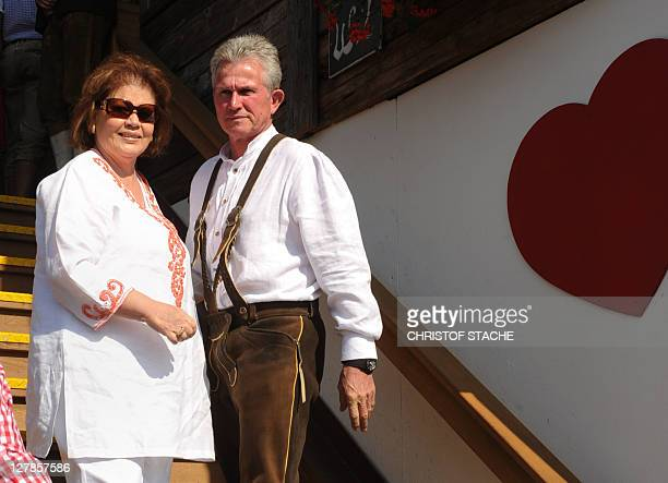 Bayern Munich's headcoach Jupp Heynckes and his wife Iris arrive dressed in traditional Bavarian clothes for the visit to the Oktoberfest in the...