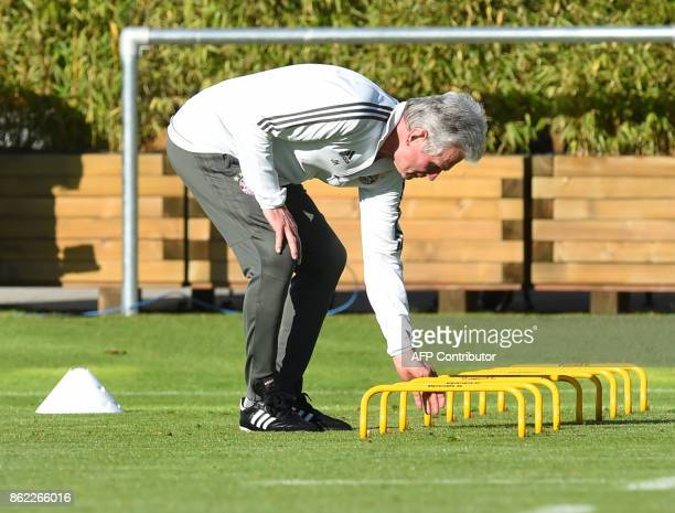 Bayern Munich's headcoach Jupp Heynckes prepares a hurdle during a training session on the eve of the Champions League group B match between Bayern...