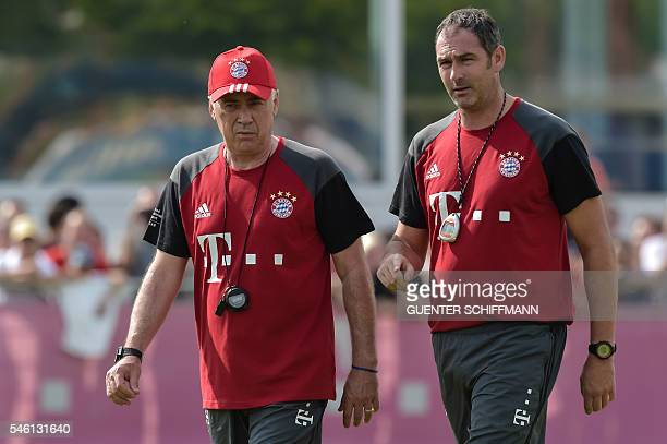 Bayern Munich's Italian head coach Carlo Ancelotti and Bayern Munich's assistent coach Paul Clement talk during the first training session with new...