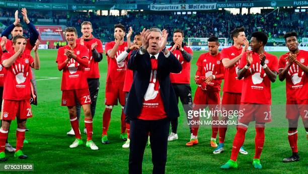 Bayern Munich's Italian head coach Carlo Ancelotti and his players celebrate after winning the German Bundesliga title and the German first division...