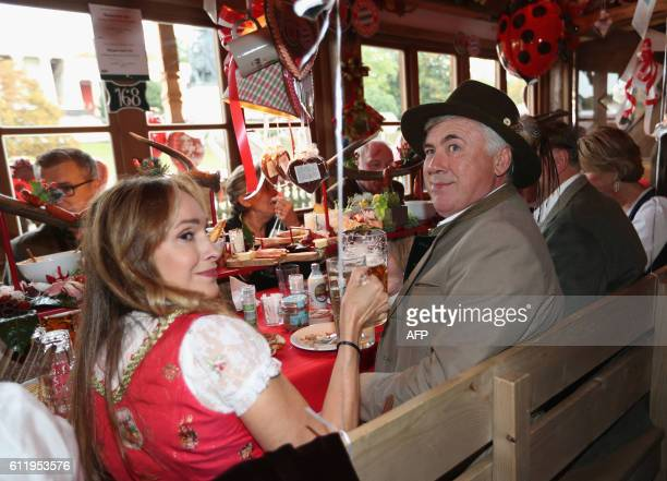 Bayern Munich's Italian head coach Carlo Ancelotti and his wife Mariann Barrena McClay during the traditional visit of FC Bayern Munich at the...