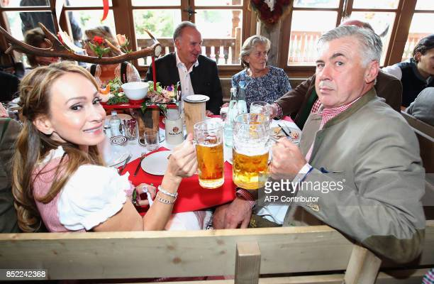 Bayern Munich's Italian head coach Carlo Ancelotti and his wife Mariann Barrena McClay pose during the traditional visit of FC Bayern Munich at the...