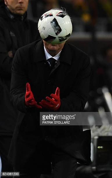Bayern Munich's Italian head coach Carlo Ancelotti catches the ball during the German first division Bundesliga football match between Borussia...
