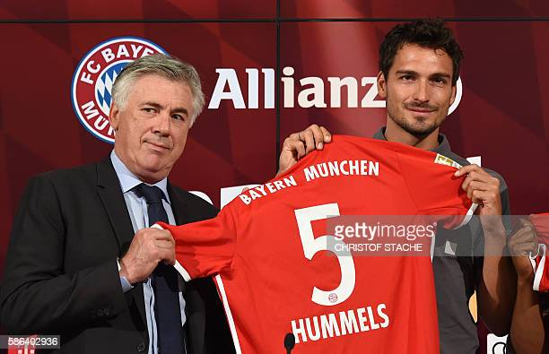 Bayern Munich's Italian headcoach Carlo Ancelotti and Bayern Munich's defender Mats Hummels pose after a press conference presenting new players of...