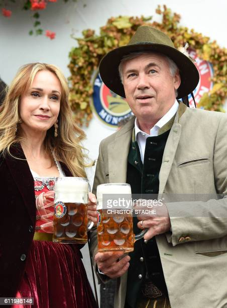 Bayern Munich's Italian headcoach Carlo Ancelotti and his wife Mariann Barrena McClay pose during the traditional visit of FC Bayern Munich at the...
