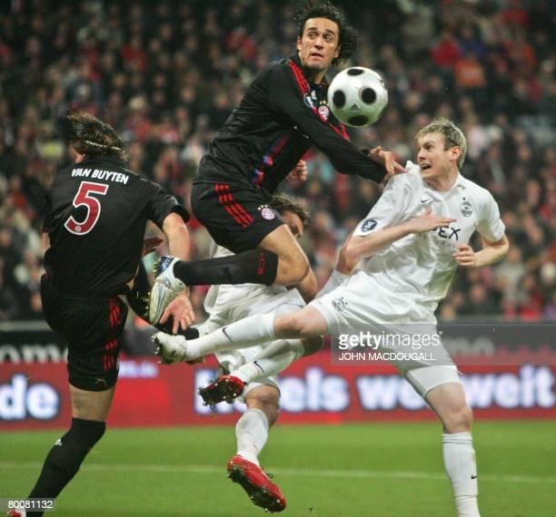 Bayern Munich's Italian striker Luca Toni and Bayern Munich's Belgian defender Daniel van Buyten vie for the ball against Aberdeen's defender...