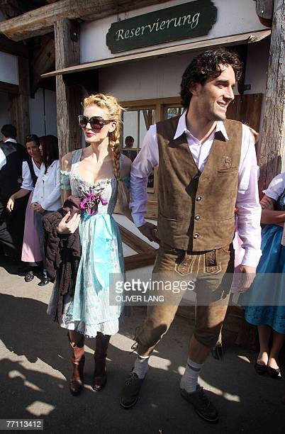 Bayern Munich's Italian striker Luca Toni and his girlfriend Marta Cecchetto pose for a photo wearing traditional Bavarian clothes as the visit the...