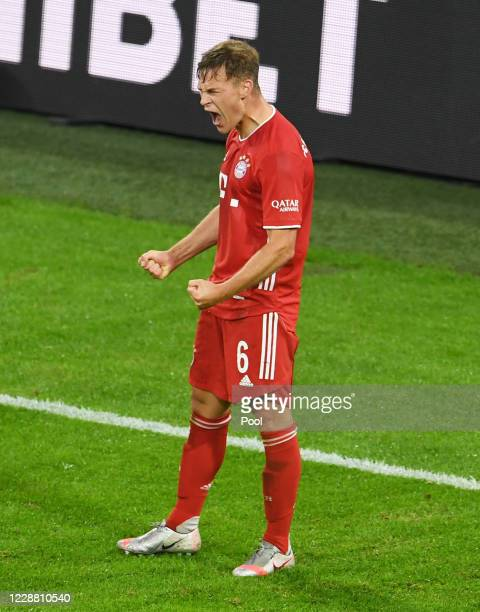 Bayern Munich's Joshua Kimmich celebrates scoring their third goal during the Supercup 2020 match between FC Bayern München and Borussia Dortmund at...