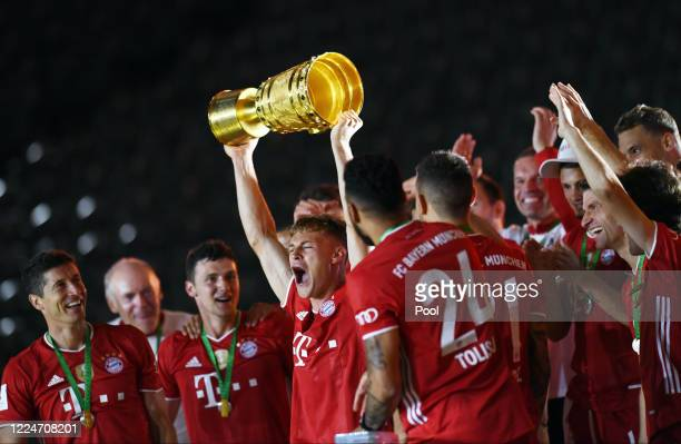 Bayern Munich's Joshua Kimmich celebrates with the trophy after their teams victory in the DFB Cup final match between Bayer 04 Leverkusen and FC...