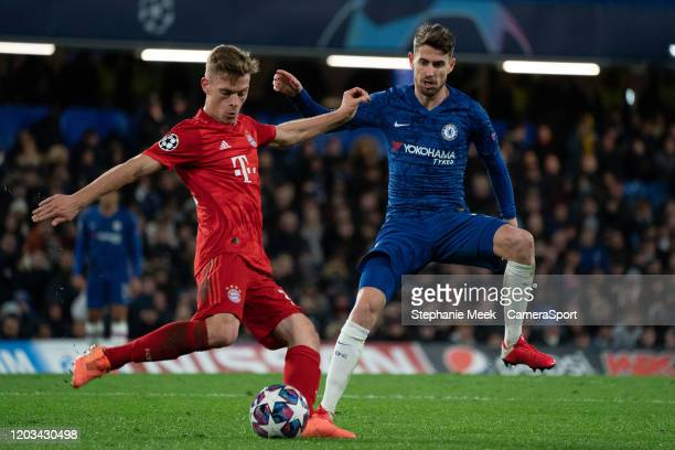 Bayern Munich's Joshua Kimmich holds off the challenge from Chelsea's Jorginho during the UEFA Champions League round of 16 first leg match between...