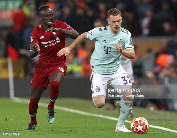 Bayern Munich's Joshua Kimmich under pressure from Liverpool's Sadio Mane during the UEFA Champions League Round of 16 First Leg match between...