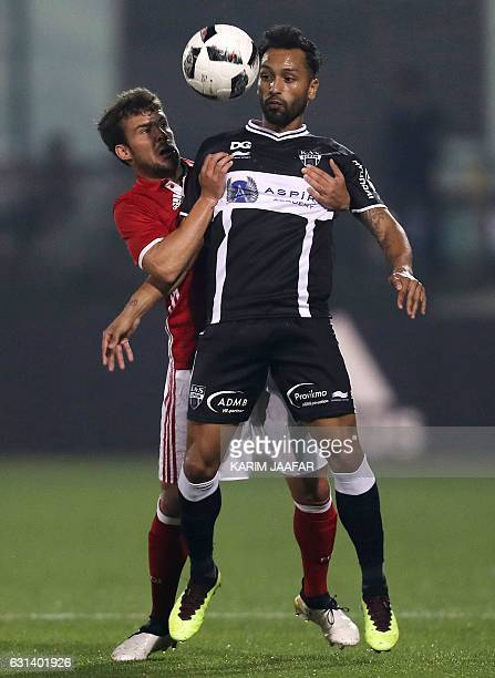 Bayern Munich's Juan Bernat vies for the ball with Jeffren Suarez of Belgium's KAS Eupen during a friendly football match at the Aspire Academy in...