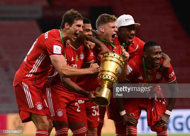 Bayern Munich's Leon Goretzka Serge Gnabry and Joshua Kimmich celebrate with the trophy following victory in the DFB Cup final match between Bayer 04...