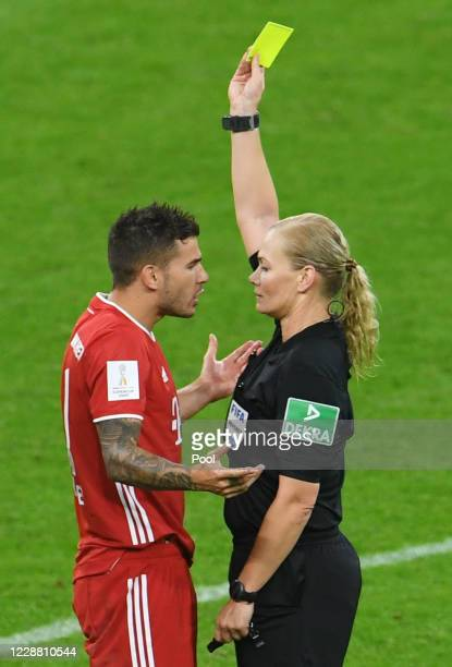 Bayern Munich's Lucas Hernandez is shown a yellow card by referee Bibiana Steinhaus during the Supercup 2020 match between FC Bayern München and...