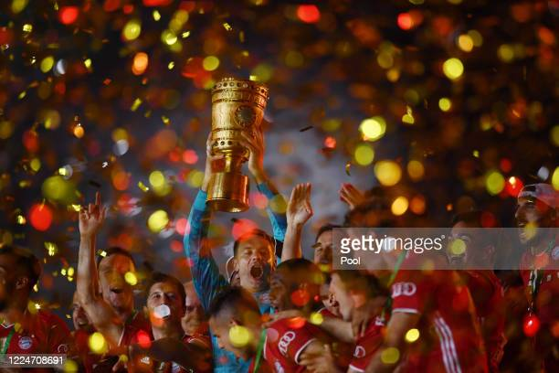Bayern Munich's Manuel Neuer celebrates with the trophy after winning the DFB Cup during the DFB Cup final match between Bayer 04 Leverkusen and FC...