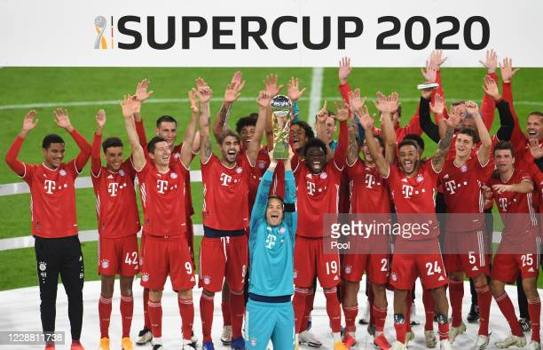 Bayern Munich's Manuel Neuer with teammates celebrate with the trophy after winning the Supercup 2020 match between FC Bayern München and Borussia...