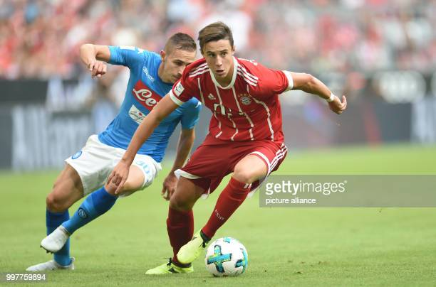 Bayern Munich's Marco Friedl leads the ball away from Naples' Marko Rog during the Audi Cup SSC Naples vs Bayern Munich match at the Allianz Arena in...
