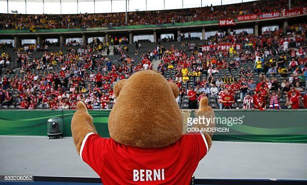 Bayern Munich's mascot Berni cheers with fans prior to the German Cup final football match Bayern Munich vs Borussia Dortmund at the Olympic stadium...