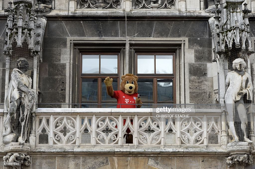 Bayern Munich's mascot waves ahead the celebration of the women and men Bundesliga title as the team celebrates the club's 25th Bundesliga title on the balcony of the city hall in Munich, southern Germany on May 24, 2015. The Bavarian giants ended their three-match losing streak in the Bundesliga with a 2-0 win over Mainz to win their 25th Bundesliga title on May 23, the last day of the league season.