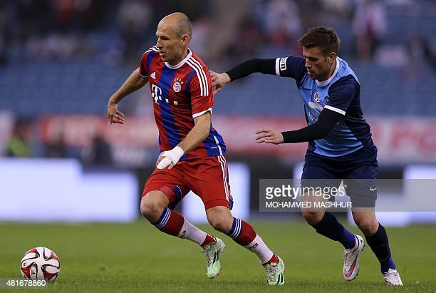 Bayern Munich's midfielder Arjen Robben dribbles the ball past AlHilal's Mihai Pintilii during their friendly football match against at the King...