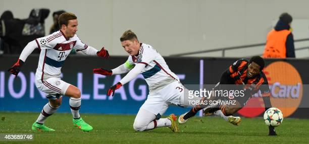Bayern Munich's midfielder Bastian Schweinsteiger and Shakhtar Donetsk's Brazilian midfielder Fred vie for the ball during the UEFA Champions League...