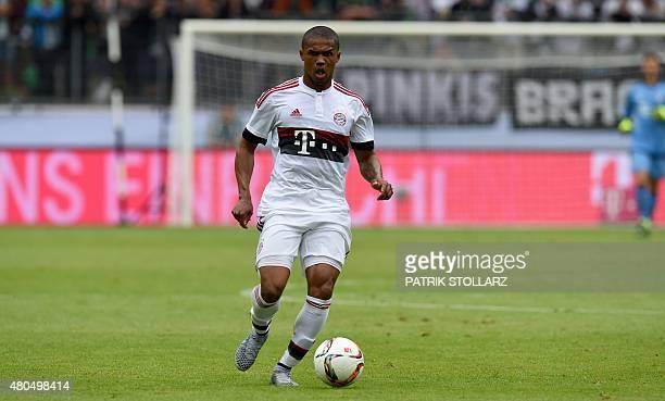 Bayern Munich's midfielder Douglas Costa plays the ball during the German Telkom Cup 2015 football match FC Augsburg vs FC Bayern Munich in...