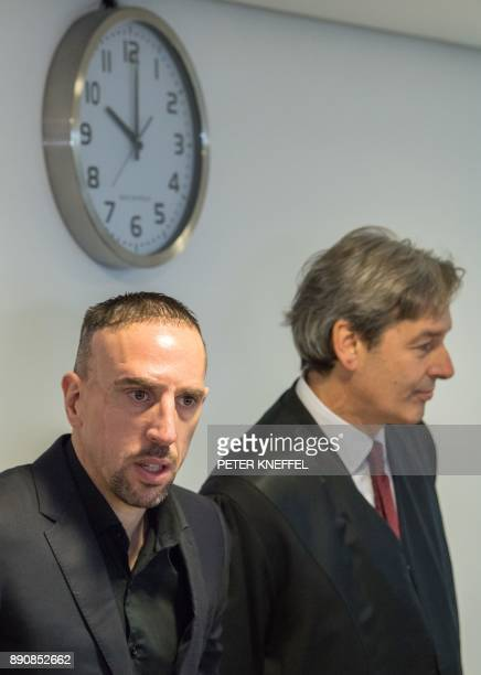 Bayern Munich's midfielder Franck Ribery and his lawyer Gerhard Riedl arrive at court over a case filed by his former agent Bruno Heiderscheid who is...