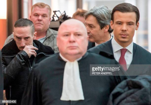Bayern Munich's midfielder Franck Ribery and his lawyers Gerhard Riedl and Carlo Brusa arrive at court over a case filed by his former agent Bruno...