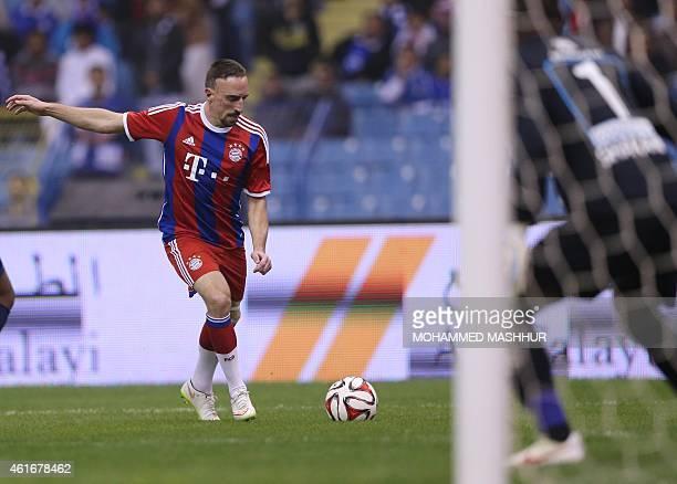 Bayern Munich's midfielder Franck Ribery takes a shot on goal during their friendly football match against Saudi's Al-Hilal club at the King Fahad...