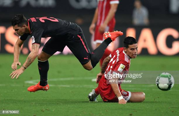 Bayern Munich's midfielder James Rodriguez and Arsenal midfielder Granit Xhaka vie for the ball during the International Champions Cup football match...
