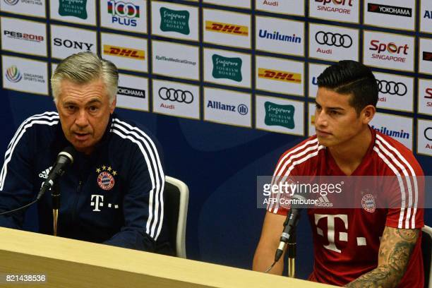 Bayern Munich's midfielder James Rodriguez and head coach Carlo Ancelotti attend a prematch press conference in Singapore on July 24 ahead of the...